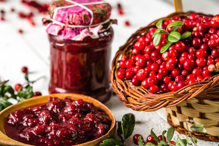 Red berry jam in a jar on table, natural organic product - homemade preserve for winter Stock Photo