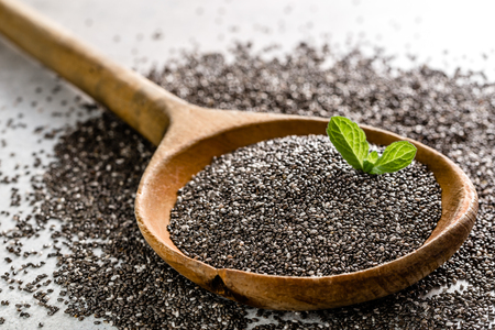 Dry healthy food - omega-3 source - macro of chia seed on wooden spoon Stock Photo