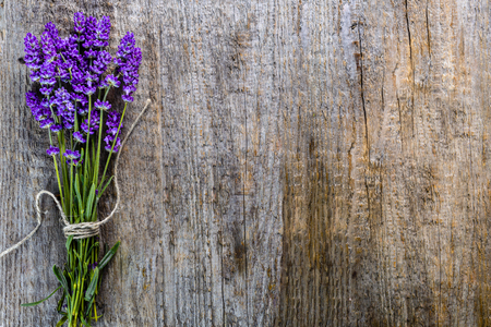 Lavender flowers, bouquet on rustic wooden background, top view