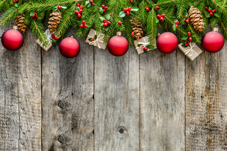 Garland with fir branches and decorations. Christmas background with copy space on wooden rustic boards Zdjęcie Seryjne