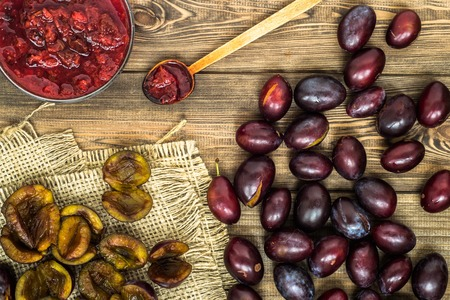 Plum jam in a bowl on wooden table, natural organic food - homemade preserve for winter