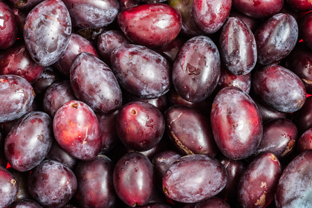 Prune plum background, whole plums natural background, top view