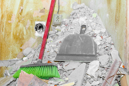 Stack of rubble during home renovation, cleaning of destroyed wall plaster
