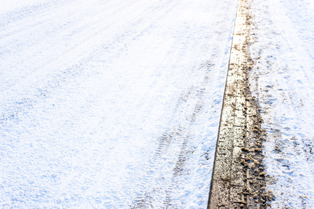 Background with snow on road in winter and walkway, texture Stock Photo