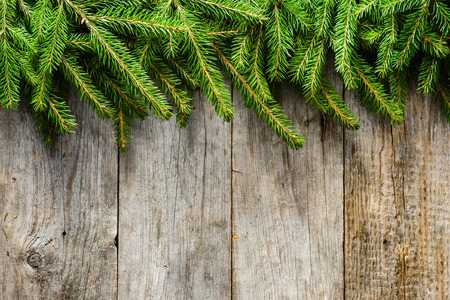 Christmas fir tree background, green branches on wooden boards, copy space Stock fotó
