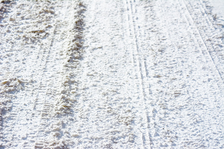 Country road in winter, snow and track of tyres Stock fotó