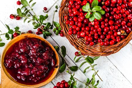 Berry jam in a bowl on wooden table, natural organic food - homemade preserve for winter Stock Photo