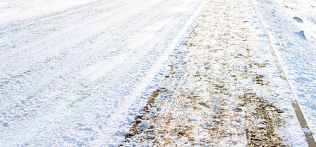 Footpath and road in winter, background with snow and sand Stock Photo