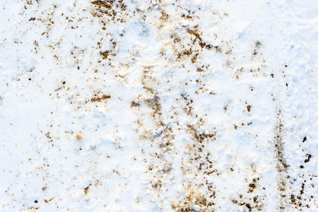 Winter texture of snow and sand, background