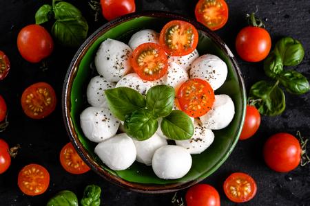 Basil, tomatoes and mozzarella for caprese salad, italian food background Stock Photo