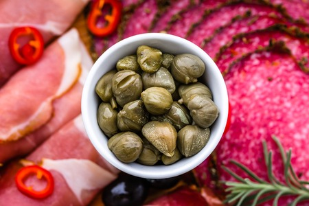 caper: Bowl of capers, italian antipasti, traditional food from italy or mediterranean cuisine ingredient Stock Photo