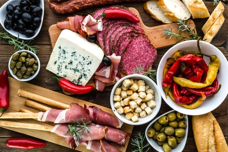hams: Table with food, tapas bar from spain, cold meat and platter with appetizers of spanish cuisine
