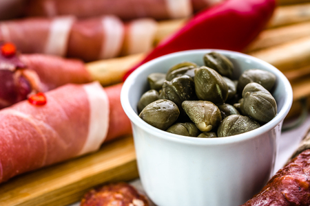 Bowl of capers, italian antipasti, traditional food from italy or mediterranean cuisine ingredient Stok Fotoğraf