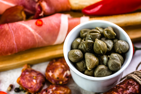 Bowl of capers, italian antipasti, traditional food from italy or mediterranean cuisine ingredient Stock Photo