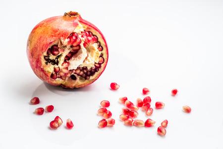 Pomegranate isolated on a white background. Фото со стока