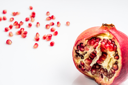 Pomegranate isolated on a white background, selective focus. Фото со стока