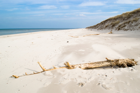Empty beach over sea with sand and blue sky, National Park in Leba, Poland