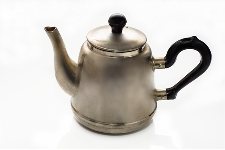 Vintage, old teapot from the samovar on a white background