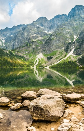 Landscape of mountain lake shore with clear water in the mountains, Morskie Oko, Tatra, Poland Stock Photo