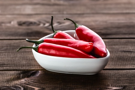 Red hot chili pepper or spicy chilli cayenne pepper, spice from mexican cuisine