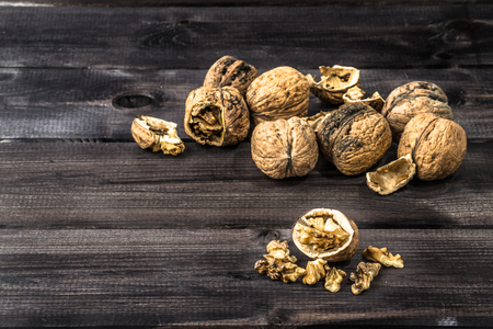 Walnuts on a wooden background.