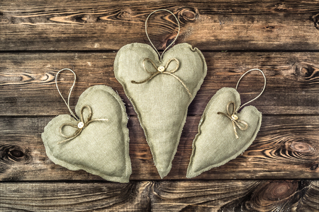 Textile decorative pillows in shape heart, christmas decoration hanging