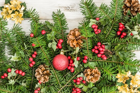Christmas background with green fir tree branch and decoration on wooden table Stock Photo