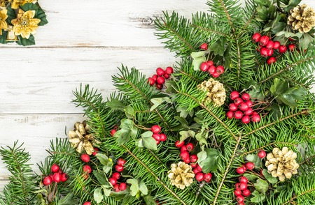 Background with christmas decoration, fir tree branch and ornaments on wooden table Stock Photo