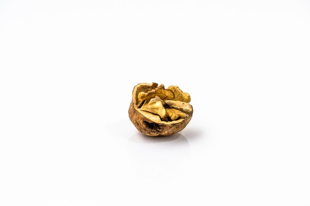 Cracked walnut on a white background. Stock Photo