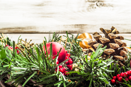 Holiday decoration. Christmas wreath on wooden background. Banco de Imagens