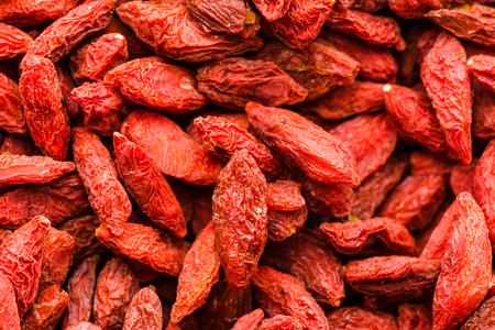 goji 베리, 질감 및 말린 과일, superfood, 배경과 자연 패턴의 빨간색 배경 중국 의학의 성분 스톡 콘텐츠