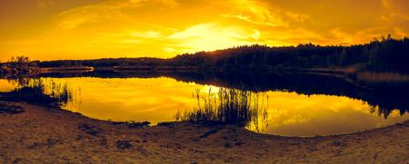Lake landscape with sunset sky, panoramic vista Stock Photo