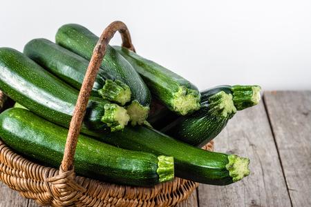 Fresh zucchini, green vegetables, farm fresh organic produce in the basket Banco de Imagens