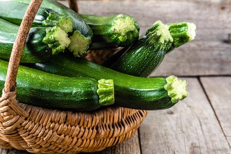 Basket with zucchini, green vegetables, organic farm fresh produce, bio food