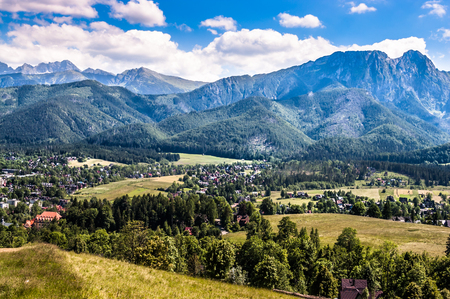 Landscape of mountains from the hiking trail to the top of mountain Gubalowka, view at valley Zakopane in the summer vacation