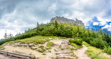 Hiking trail in mountains, landscape, path with rocks leading to the peak of mountain