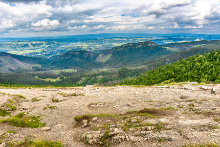 Hiking trail in mountains with view on valley, panorama of city Zakopane, panoramic vista of hills and forest Stock Photo