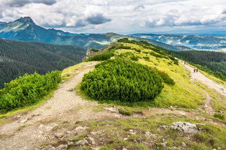 Ridge of mountain with hiking trail and tourist traveling in Tatra Mountains, landscape Stock fotó