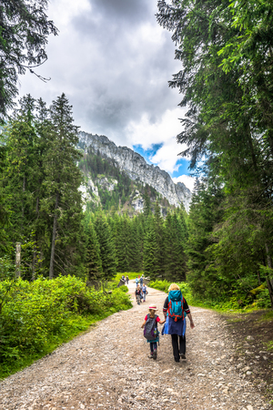 ZAKOPANE, POLAND - AUGUST 15, 2016: Mountain hikers on hiking trail in Tatra Mountains, tourism in Poland