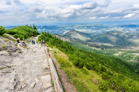 ZAKOPANE, POLAND - AUGUST 16, 2016: Group of hikers on hiking trail, trekking in Tatra Mountains, tourist travel concept
