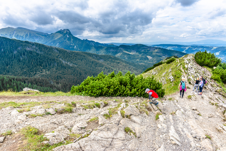ZAKOPANE, POLAND - AUGUST 16, 2016: Group of hikers on hiking trail in mountains, landscape, Poland