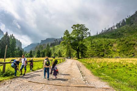 ZAKOPANE, POLAND - AUGUST 15, 2016: Mountain hikers on hiking trail in Tatra Mountains, hiking in Poland