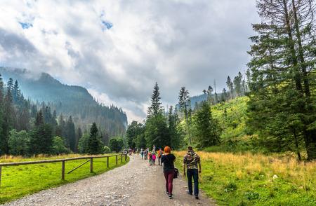 ZAKOPANE, POLAND - AUGUST 15, 2016: Mountain tourists on hiking trail in Tatra Mountains, hiking in Poland