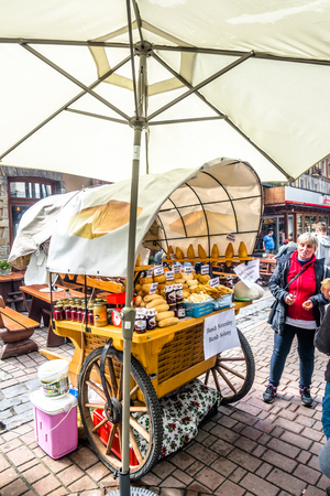 ZAKOPANE, POLAND - AUGUST 17, 2016: Street trading in the city center of Zakopane - sale of oscypek, traditional polish snack - street food and tourist attraction in the summer season Sajtókép