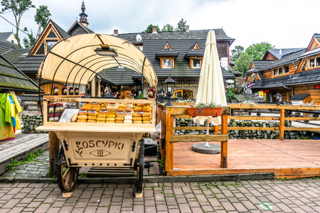 ZAKOPANE, POLAND - AUGUST 17, 2016: Street trading in the city center of Zakopane - sale of oscypek, traditional polish smoked cheese - street food and tourist attraction in the summer season Editorial