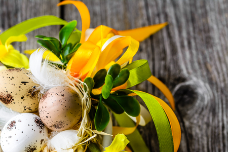 Easter background with spring easter eggs and flowers on wooden table Reklamní fotografie - 93930120