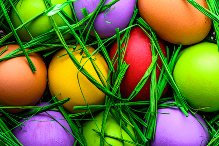 Easter eggs in green grass, eggs background