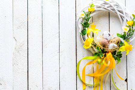 Easter background with spring wreath hanging on door