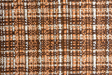 Old textile background, woven checkered pattern in vintage style
