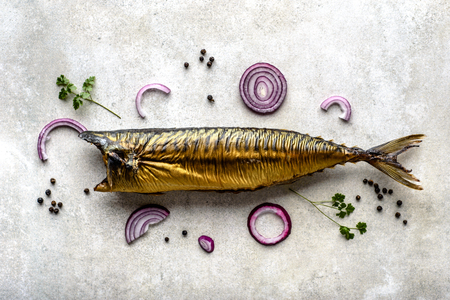 Mackerel. Smoked fish on table, food with omega 3 fat, healthy eating concept